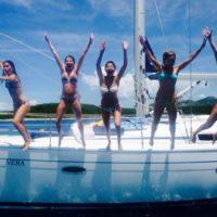 Jumping off our boat on islands, near Split, Croatia