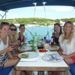 Guests enjoying lunch on day sailing trip in Split, Croatia